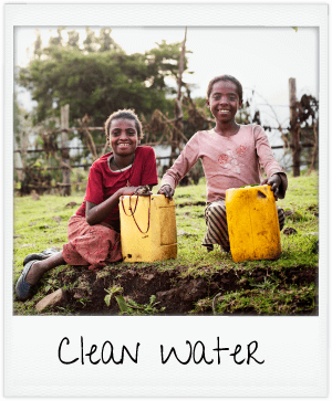 clean water - girls holding water jugs