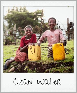 clean water - girls holding water jugs